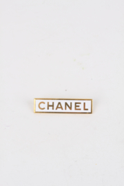 Chanel 1990's Gold-Plated White Enamel Logo Sales Assistant Pin Brooch