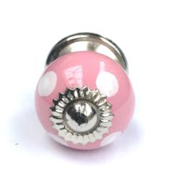 Vrolijk roze kastknop, roze kastknopje met witte stippen
