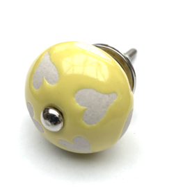 Gele kastknop met hartjes