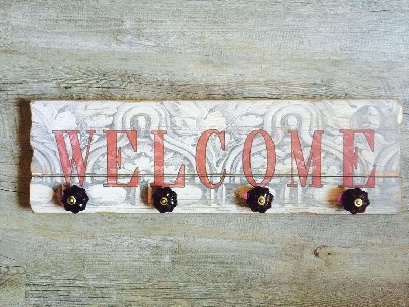 Kapstokhaak 'WELCOME' paars robijn kleurige knoppen