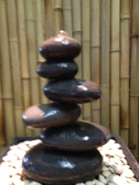 Waterornament pillar and pebbles