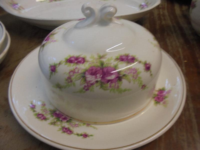 Botervloot met dubbele roze roosjes en kruloortje