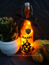 Verlichte fles Halloween huis