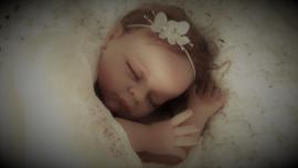 Set newborn wrap + bijpassend haarbandje 'creme'
