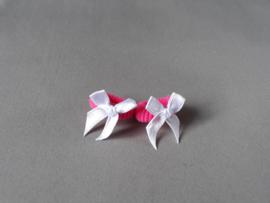 Baby elastiekje fuchsia met wit strikje