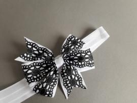 Baby/ peuter haarbandje met strik 'zwart/wit'