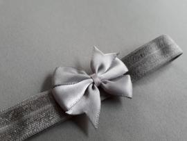 Baby/ peuterhaarbandje grijs met klein strikje