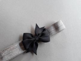 Baby/ peuter haarbandje met zwart strikje