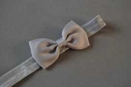 Baby/ peuter haarbandje met strikje 'grijs'