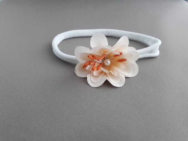 Baby haarbandje wit met bloem/pareltje