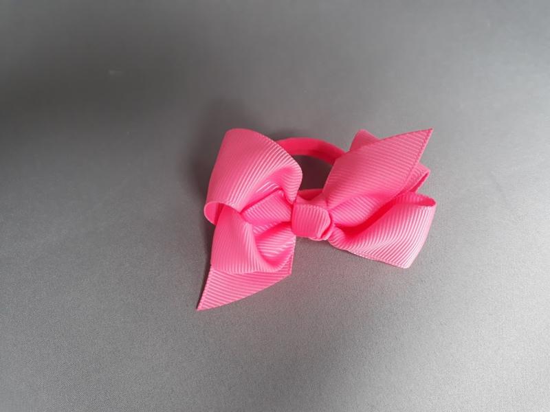 Elastiek strik 'fel roze'