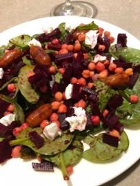 Red beet salat with warm chistorritas sausages