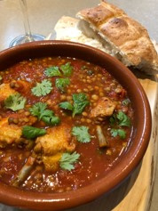 Tomato lentil stew with pollo al ajillo chicken