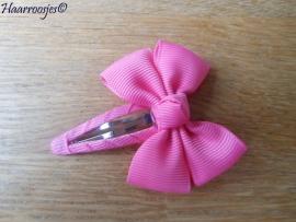 Haarspeldje meisje, met een roze strik.