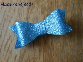 Strik, blauw met glitter.