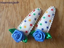 Haarspeldjes, meisje, gekleurde sterren met blauw roosje.
