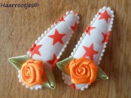 Haarspeldjes, meisje, oranje sterren met oranje roosje.