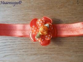 Elastisch haarbandje, oranje, met effen bloem, polkadot bloemetje en oranje roosje.