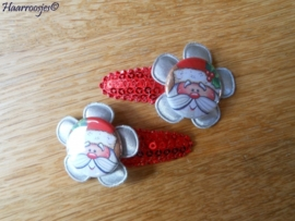 Haarspeldjes, peuter/kleuter, rood met pailleten met zilver grijze bloem en een kerstman.