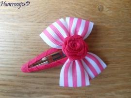 Haarspeldje meisje, met een fuchsia roze gestreepte strik met fuchsia roze roosje.