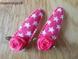 Haarspeldjes, meisje, fuchsia roze met witte sterren en een fuchsia roze roos.