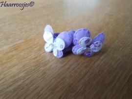 Zachte elastiekjes, klein, paars met paarse vlinders.