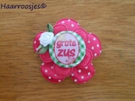 Haarlokspeldje, fuchsia roze polkadot , fuchsia roze kanten bloem, 'Grote zus' (met groen) en fuchsia roze roosje.