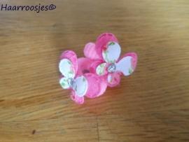 Zachte elastiekjes, klein, roze met roze vlinders.