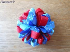 Pompoms, rood en blauw.