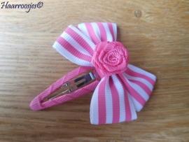 Haarspeldje meisje, met een roze gestreepte strik met roze roosje.