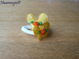 Zachte elastiekjes, groot, wit met geel polkadot vlinder met oranje roosje.