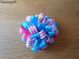 Pompoms, roze, lichtblauw en wit.