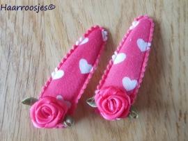 Haarspeldjes, meisje, fuchsia roze met witte hartjes en een fuchsia roze roos.