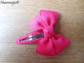 Haarspeldje meisje, met een fuchsia roze strik.