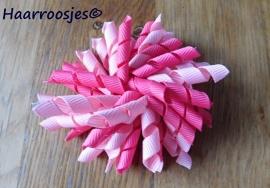Krulliesss, fuchsia roze en lichtroze.