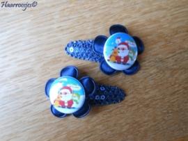Haarspeldjes, peuter/kleuter, donkerblauw met pailleten met satijnen bloem en een kerstman.