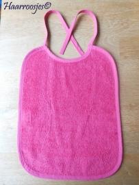 Slabbetje, fuchsia roze badstof met fuchsia roze biaisband (eventueel zelf naam of tekst kiezen).