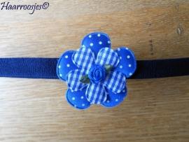 Babyhaarbandje, smal, donkerblauw, met polkadot bloem, geruite bloemetje en een blauw roosje.