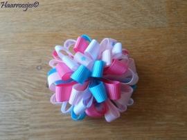 Pompoms, roze, lichtroze, lichtblauw en wit.