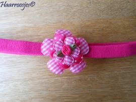 Babyhaarbandje, smal, fuchsia roze, met geruite bloem, polakdot bloem, geruit bloemetje en een fuchsia roze roosje.