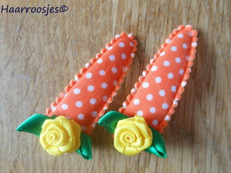 Haarspeldjes, meisje, oranje polkadot met geel roosje.