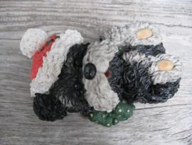 beeldje liggende kerstpuppy