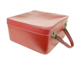 Oude koffer met lang handvat