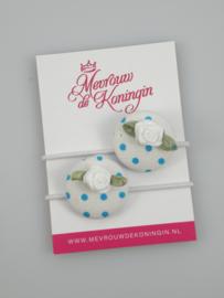 Stofknoop blauw gestipt met wit roosje