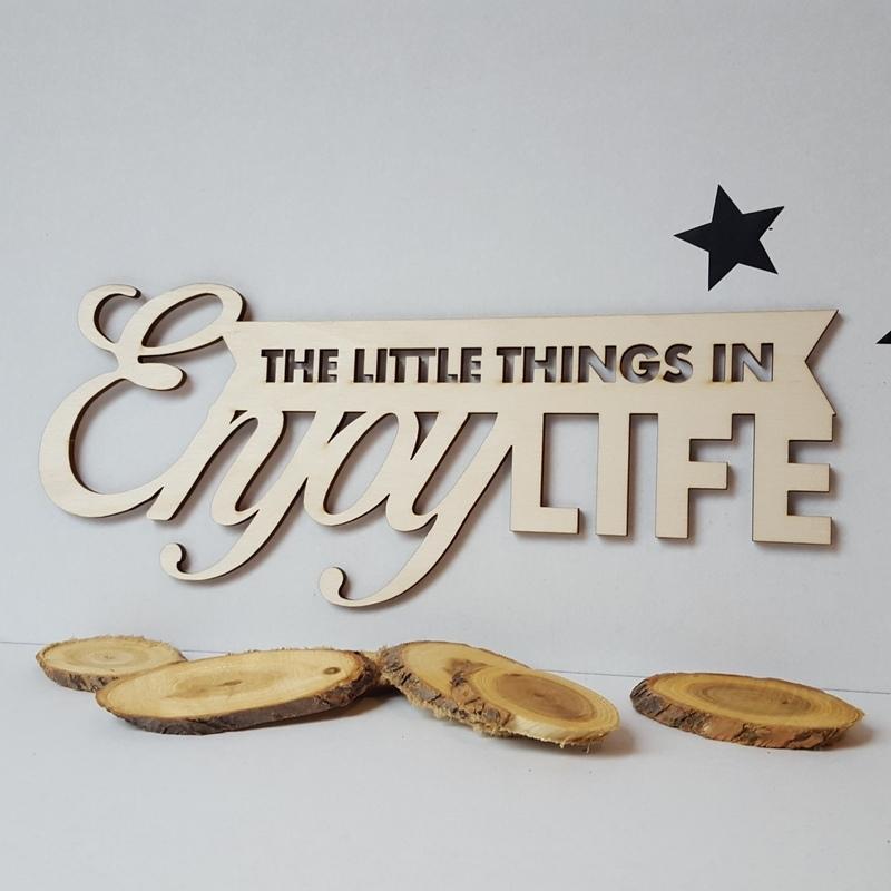 Houten tekst 'Enjoy the little things in life'
