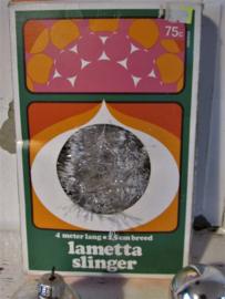 in OVP; Oude LAMETTA slinger HEMA. Transparant met witte topjes! 4 meter