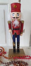 Kerst Notenkraker met rode glitter. 25 cm. hoog