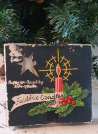 Oud en sleets doosje kerstboomkaarsjes