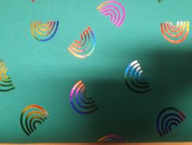 Groene stof met gekleurde cirkels