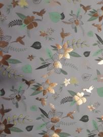 Witte tricot stof  met gouden bloemen